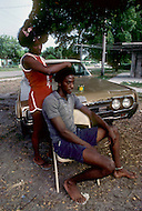 Miami, Florida, U.S.A, September, 1980. America severely marked by the recession. Homosexuals living in the ghetto, Liberty City.