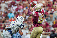 TALLAHASSEE, FLA 9/10/16-Florida State's Travis Rudolph pulls in the Seminole's first touchdown as Charleston Southern's D.J. Curl closes during first quarter action Saturday at Doak Campbell Stadium in Tallahassee. <br /> COLIN HACKLEY PHOTO