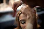Model Viviane Orth gets her hair done backstage for the Brazilian brand, Neon, at São Paulo Fashion Week for Summer Season 2013/2014, at Bienal, in São Paulo, Brazil, on Wednesday, March 20, 2013.