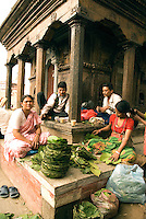 Locals set up a market and sip butter tea at one of the ancient temples in Kathmandu's Durbar Square.