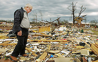 James Devaney searches through the debris of his daughter's home on County Rd. 183 in the Aldridge Grove community of Lawrence County, AL Wednesday, February 6, 2008.  Devaney's daughter Becky Coleman was killed along with her son Gerrick and her husband Greg when the tornado hit at 3:06 a.m.