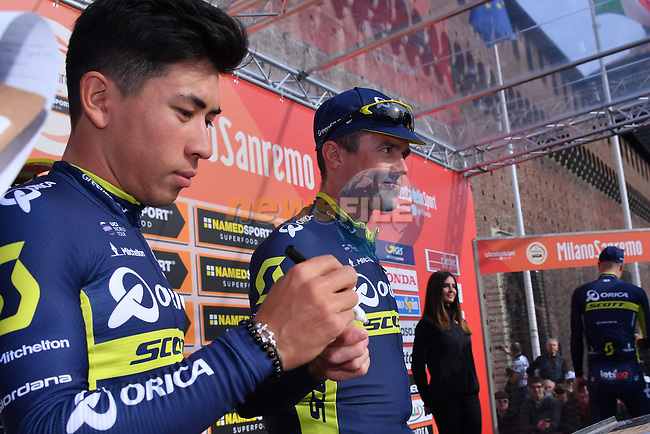 Sprinter Caleb Ewan and Simon Gerrans (AUS) Orica-Scott at sign on before the start of the 108th edition of Milan-San Remo 2017 by NamedSport the first Classic Monument of the season running 291km from Milan to San Remo, Italy. 18th March 2017.<br /> Picture: La Presse/Gian Mattia D'Alberto | Cyclefile<br /> <br /> <br /> All photos usage must carry mandatory copyright credit (&copy; Cyclefile | La Presse)