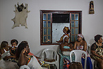 RIO DE JANEIRO, BRAZIL - JANUARY 24: Practitioners take a break during a candomble ceremony, in Rio de Janeiro, Brazil, on Saturday, Jan. 23, 2015. Brazil's Afro-Brazilian religions which in recent years have come under increasing threats and prejudice, particularly from the growing number of evangelical churches. Candombl&eacute; originated in Salvador, Bahia at the beginning of the 19th century when enslaved Africans brought their beliefs with them. Umbanda and candombl&eacute; are Afro-Brazilian religions practiced in mostly Brazil. <br /> (Lianne Milton for the Washington Post)