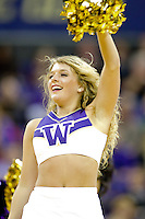 February 12, 2014:   UW Cheer member Jordan French entertained fans during the game between Washington's against Stanford.  Washington defeated Stanford 64-60 at Alaska Airlines Arena in Seattle, Washington.