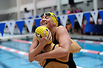 25 MAR 2011:  April Whitley (right) of Emory hugs a team mate after winning the 100 yard breaststroke during the Division III Men's and Women's Swimming and Diving Championship help at Allan Jones Aquatic Center in Knoxville, TN.  Whitney finished with a time of 1:02.11 to win the national title. David Weinhold/NCAA Photos