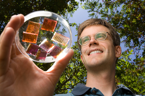 Mike McGehee, Stanford assistant professor in material sciences and engineering holding printable solar cells.