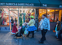 Families trick or treat businesses after the 24th Annual Jackson Heights Halloween Parade in Jackson Heights in the Queens borough of New York on Thursday, October 31, 2013. Over three thousand neighborhood residents marched down 37th Ave., a main shopping street, with the children receiving treats at the end of the parade courtesy of the Jackson Heights Beautification Committee. (© Richard B. Levine)