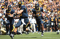 Quarterback Kevin Riley, blocks for wide receiver Keenan Allen on the play. The University of California Berkeley Golden Bears defeated the UC Davis Aggies 52-3 in their home opener at Memorial Stadium in Berkeley, California on September 4th, 2010.