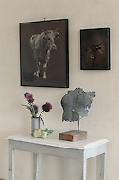 In the living room a charming still-life of thistle flowers and cardoons has been arranged on a painted antique table