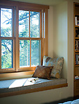 A bedroom window seat offers a quiet place to read in this Pacific Northwest home. This image is available through an alternate architectural stock image agency, Collinstock located here: http://www.collinstock.com