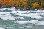 Autumn Fall color in Autrain Michigan on Lake Superior with large waves rolling in