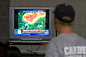 A man watches the local television news while taking shelter in the Springfield Civic Center in downtown Springfield, MA where a tornado struck on Wednesday afternoon June 1, 2011. The city opened the center to residents who were victimized by the storm.  (Matthew Cavanaugh for The Boston Globe)