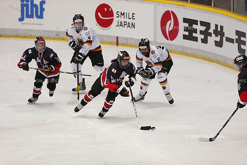 (L to R) Yurie Adachi (JPN), Ayaka Toko (JPN), Delarbre Marie (GER), NOVEMBER 10, 2013 - Ice Hockey : Ice Hockey Womens 5 Nations Tournament SMILE JAPAN BRIDGESTONE BLIZZAK CHALLENGE between Germany Women's 3-1 Japan Women's at Shinyokohama Skate Center, Kanagawa, Japan. (Photo by AFLO SPORT)