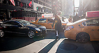 Shoppers on Fifth Avenue in New York maneuver through gridlock on Friday, December 13, 2013 during the Christmas shopping season. There are only twelve more days until Christmas!(© Richard B. Levine)