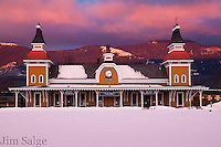 An intense sunrise lights up the clouds and mountains over the North Conway Train Station.