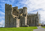 The Rock of Cashel, a partially destroyed castle at Cashel, Ireland and a popular tourist site. Parts of the castle, including Cormac's Chapel (currently under restoration), date from the 12th century.