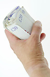 Hand Holding Rolled Up Twenty Pound Notes - Jul 2013.