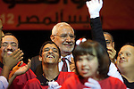 Egyptian Islamist presidential candidate Abdul Moneim Aboul Fotouh joins a group of mentally disabled youth actors on stage during a May 15, 2012 campaign stop in the Mohandiseen district of the Egyptian capital, Cairo. Fotouh's campaign has managed to gather momentum in the final weeks of the campaign by drawing support from a broad coalition of groups including Islamists, revolutionary youth, and women. (Photo by Scott Nelson)