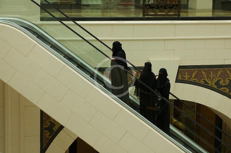 United Arab Emirates, Dubai, Emirati women on escalator, shoppng mall
