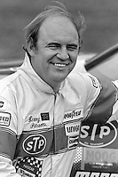 DAYTONA BEACH, FL - FEBRUARY 14: Benny Parsons pauses in the pit lane after qualifying the Harry Ranier Pontiac for the Daytona 500 NASCAR Winston Cup race at the Daytona International Speedway in Daytona Beach, Florida, on February 14, 1982.