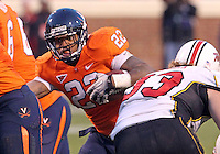 Nov 13, 2010; Charlottesville, VA, USA;  Virginia Cavaliers running back Keith Payne (22) runs past Maryland Terrapins defensive lineman Andre Monroe (93) during the 1st half of the game at Scott Stadium.  Mandatory Credit: Andrew Shurtleff