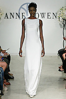 "Model walks runway in a Baron Bridal dress - orchid white 4-ply silk gown with back beaded detail, from the Anne Bowen Bridal Spring 2013 ""Coat of Arms"" collection fashion show, during Bridal Fashion Week New York April 2012."