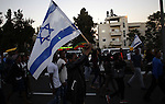 Israeli Ethiopians march during a demonstration to demand an investigation into alleged police racism and violence, in downtown Jerusalem on April 30, 2015. Clashes broke on April 30 in Jerusalem, as more than 1,000 angry Ethiopian Israelis staged a protest, sparked by a series of incidents involving alleged racism and police brutality against members of the Ethiopian Jewish community. Photo by Saeb Awad