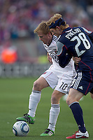 New England Revolution midfielder Pat Phelan (28) closely defends DC United midfielder Dax McCarty (10). In a Major League Soccer (MLS) match, the New England Revolution defeated DC United, 2-1, at Gillette Stadium on March 26, 2011.