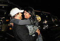 Nov. 13, 2011; Pomona, CA, USA; NHRA top fuel dragster driver Del Worsham celebrates with wife Connie Worsham after winning the World Finals at the Auto Club Finals at Auto Club Raceway at Pomona. Mandatory Credit: Mark J. Rebilas-.