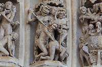 Scenes of torture in hell, from the archivolts of the central portal, known as the Beau-Dieu portal, dedicated to the Last Judgment, on the Western facade of the Basilique Cathedrale Notre-Dame d'Amiens or Cathedral Basilica of Our Lady of Amiens, built 1220-70 in Gothic style, Amiens, Picardy, France. Amiens Cathedral was listed as a UNESCO World Heritage Site in 1981. Picture by Manuel Cohen