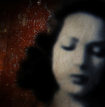textured image of a beautiful woman with her eyes closed and wood texture behind