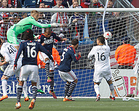 Vancouver Whitecaps FC goalkeeper David Ousted (1) punches the ball clear. In a Major League Soccer (MLS) match, the New England Revolution (blue/white) tied Vancouver Whitecaps FC (white), 0-0, at Gillette Stadium on March 22, 2014.