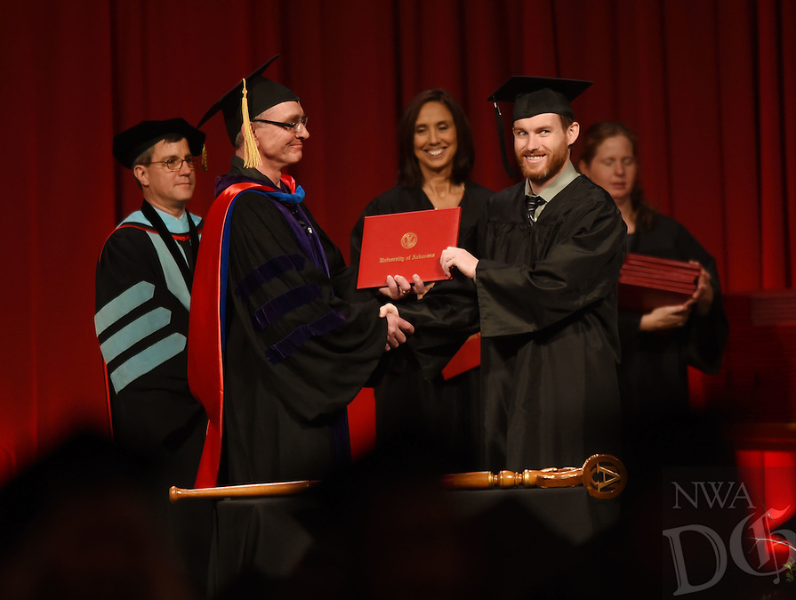 NWA Democrat-Gazette/MICHAEL WOODS &bull; @NWAMICHAELW<br /> University of Arkansas students during the 2016 Fall Commencement at Bud Walton Arena Saturday, December 17, 2016 in Fayetteville.  More than 1,800 University of Arkansas students graduated this fall with about 1,200 participating in Saturdays Commencement ceremony.