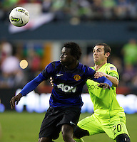 Manchester United defender Mame Biram Diouf, left, battles with Seattle Sounders FC forward Zach Scott during at CenturyLink Field in Seattle Wednesday July 20, 2011. Manchester United won the match 7-0.