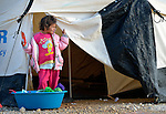 A girl in the Zaatari Refugee Camp, located near Mafraq, Jordan. Opened in July, 2012, the camp holds upwards of 50,000 refugees from the civil war inside Syria, but its numbers are growing. International Orthodox Christian Charities and other members of the ACT Alliance are active in the camp providing essential items and services.