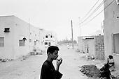 Salalah, Oman.July 2001..Fishermen outside their home.