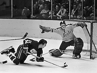 Seal golie Gilles Meloche block the goal without his stick, against Vancouver Canucks Wayne Maki.(1971-72 photo/Ron Riesterer)