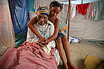Jenny Beamy Ais , 17, with her blind great grandmother Frezilia Cetoute, 109, (cq all) inside their makeshift tent on a former soccer field at Sainte Therese Park in Petion-Ville on February 27, 2010. The family has been surviving with remittances from relatives in Miami.