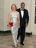 John W. Thompson, CEO of Virtual Instruments, and Sandi Thompson arrive for the Official Dinner in honor of Prime Minister David Cameron of Great Britain and his wife, Samantha, at the White House in Washington, D.C. on Tuesday, March 14, 2012. The Thompsons are two of United States President Barack Obama's biggest campaign fundraisers..Credit: Ron Sachs / CNP.(RESTRICTION: NO New York or New Jersey Newspapers or newspapers within a 75 mile radius of New York City)
