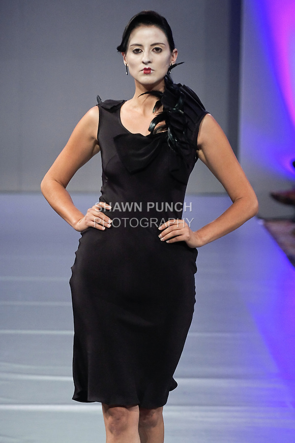 Model walks the runway in an outfit from the Pilar Macchione - Noir collection, during Couture Fashion Week Spring 2012.