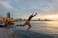 Boys swimming at the Malecon.