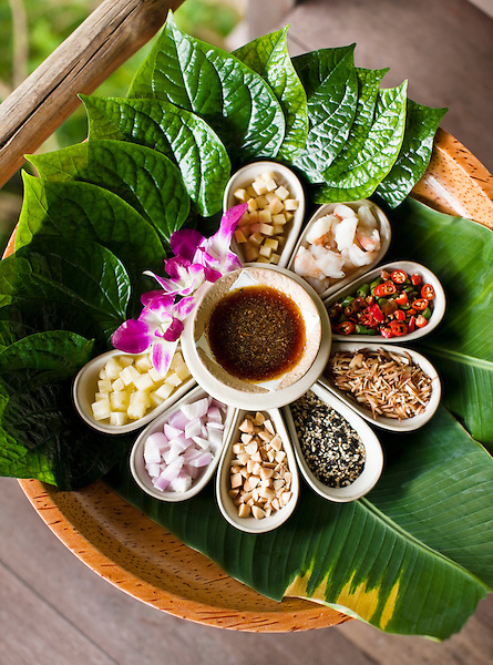 Thai Food Platter at Kamalaya, Koh Samui, Thailand. A Thai platter with betel leaves, pineapple, red onion, peanuts, seasame seeds, toasted coconut, chili, shrimp and ginger with tamarind dipping sauce at Amrita Cafe at Kamalaya resort.