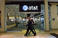 New York, United States. 19th May 2014 -People walk in front of one AT&T store in Jersey City, New Jersey. Photo by Eduardo MunozAlvarez/VIEW