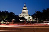 The Texas State Capitol shines bright while illuminated at night in downtown Austin, Texas.