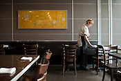 Jesse Rice-Evans, a server at Sandwhich, in Chapel Hill, sets out silverware for the dinner shift.
