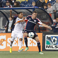 New England Revolution defender Chris Tierney (8) attempts to control the ball as Real Salt Lake forward Joao Plata (8) defends. In a Major League Soccer (MLS) match, Real Salt Lake (white)defeated the New England Revolution (blue), 2-1, at Gillette Stadium on May 8, 2013.