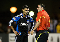 Chris Wondolowski of Earthquakes argues with the referee Paul Ward about a bad call during the game against the WhiteCaps at Buck Shaw Stadium in Santa Clara, California on July 20th, 2011.  Earthquakes and WhiteCaps are tied 2-2 at the end of the game.