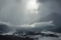 Approaching storm creating mist among glacial lake in Mount Cook national park, New Zealand