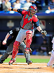 2 March 2010: Atlanta Braves catcher Clint Sammons is unable to make a play on a sliding New York Mets' Ike Davis during the Opening Day of Grapefruit League play at Tradition Field in Port St. Lucie, Florida. The Mets defeated the Braves 4-2 in Spring Training action. Mandatory Credit: Ed Wolfstein Photo