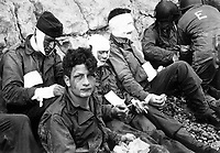 American assault troops of the 16th Infantry Regiment, injured while storming Omaha Beach, wait for the Chalk Cliffs for evacuation to a field hospital for further medical treatment.  Collville-sur-Mer, Normandy, France.  June 6, 1944.  Taylor.  (Army)<br /> NARA FILE #:  111-SC-189910<br /> WAR &amp; CONFLICT BOOK #:  1043